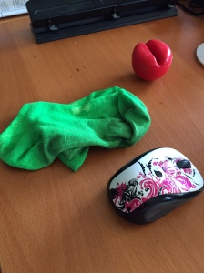 Dirty socks on the desk. And a red nose. So what?